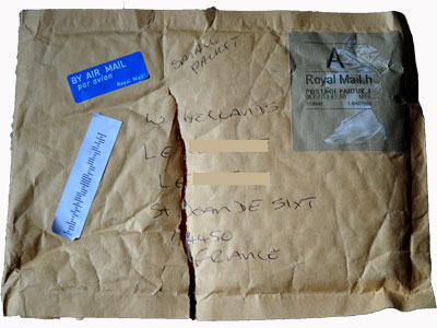 <Photo of a package damaged in transit that nobody seems to be responsible for>