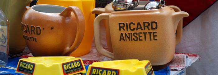 <Photo of Ricard jugs at a vide grenier in Le Grand Bornand, France'>